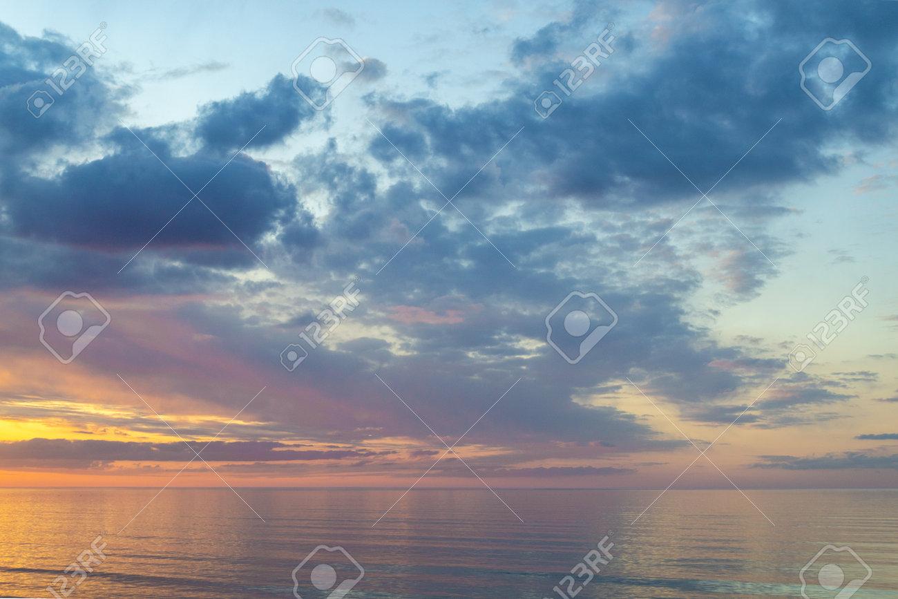 Summer mood. Beautiful colorful sunset over Baltic sea in Jurmala resort, Latvia. Warm evening on beach. Scenery view. - 168914541