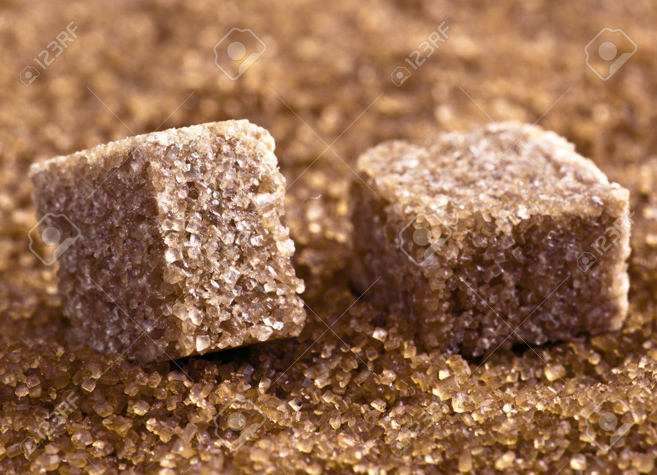 http://previews.123rf.com/images/jultud/jultud1204/jultud120400041/13089400-brown-sugar-cubes-on-powdered-sugar-Stock-Photo.jpg