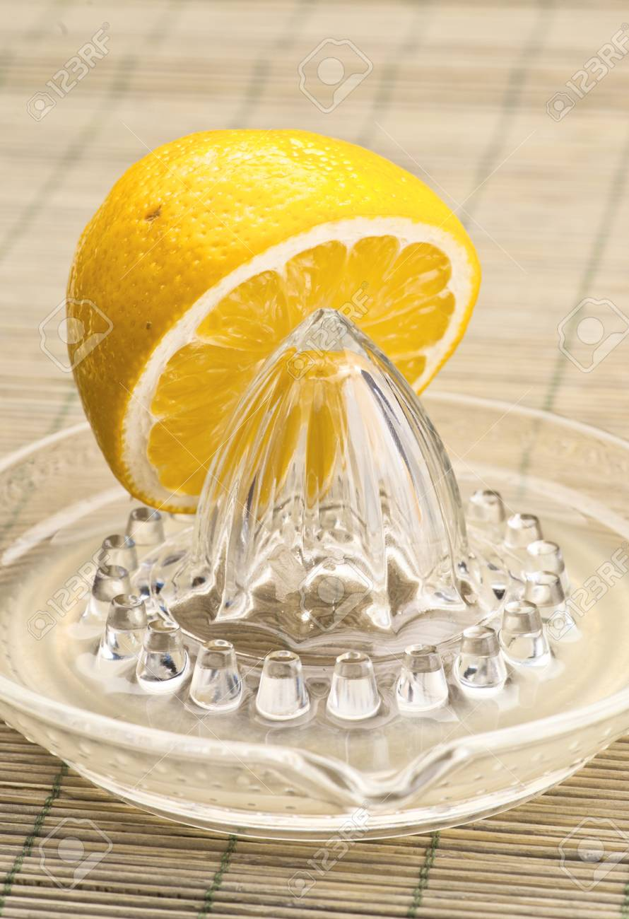 half a lemon squeezed on natural base Stock Photo - 14313107