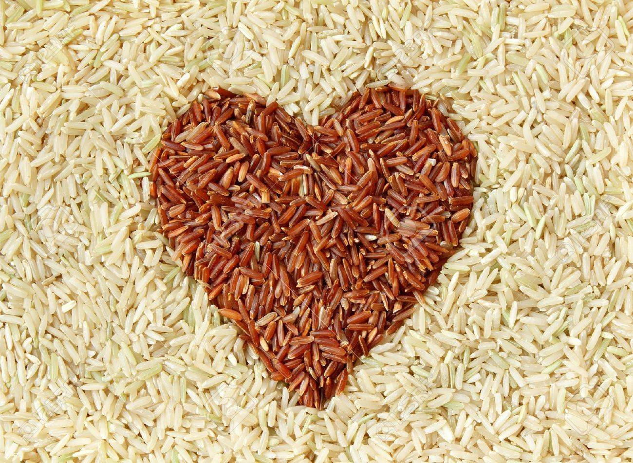 Brown rice and red rice with heart shape texture background Stock Photo - 12747828