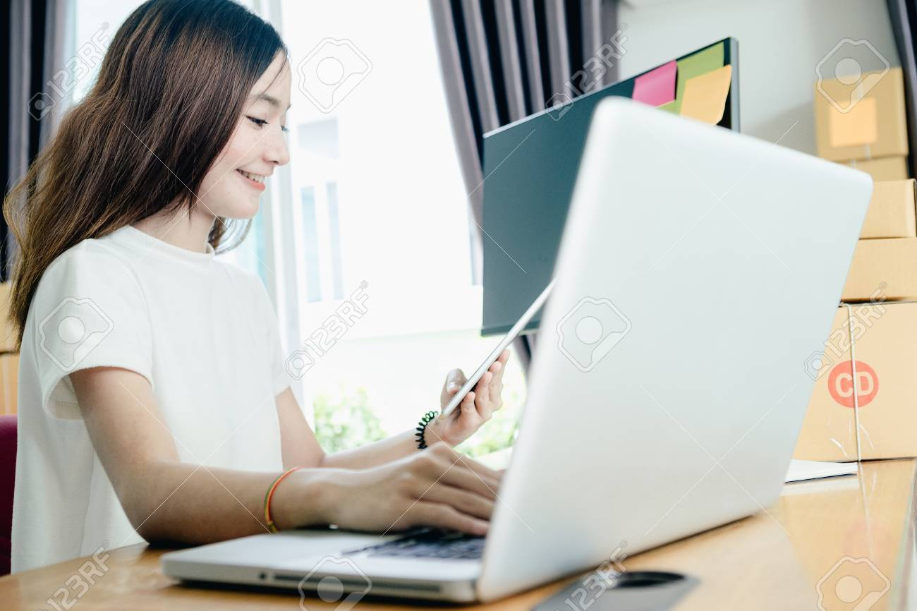Young Asian Girl Is Freelancer With Her Private Business At Home ...