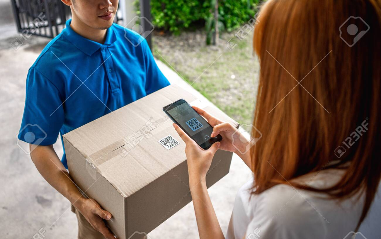 Asian deliveryman is delivering parcel to house her to sign to receive the product After she ordered online during the outbreak of the coronavirus or Covid-19 virus. - 148855846