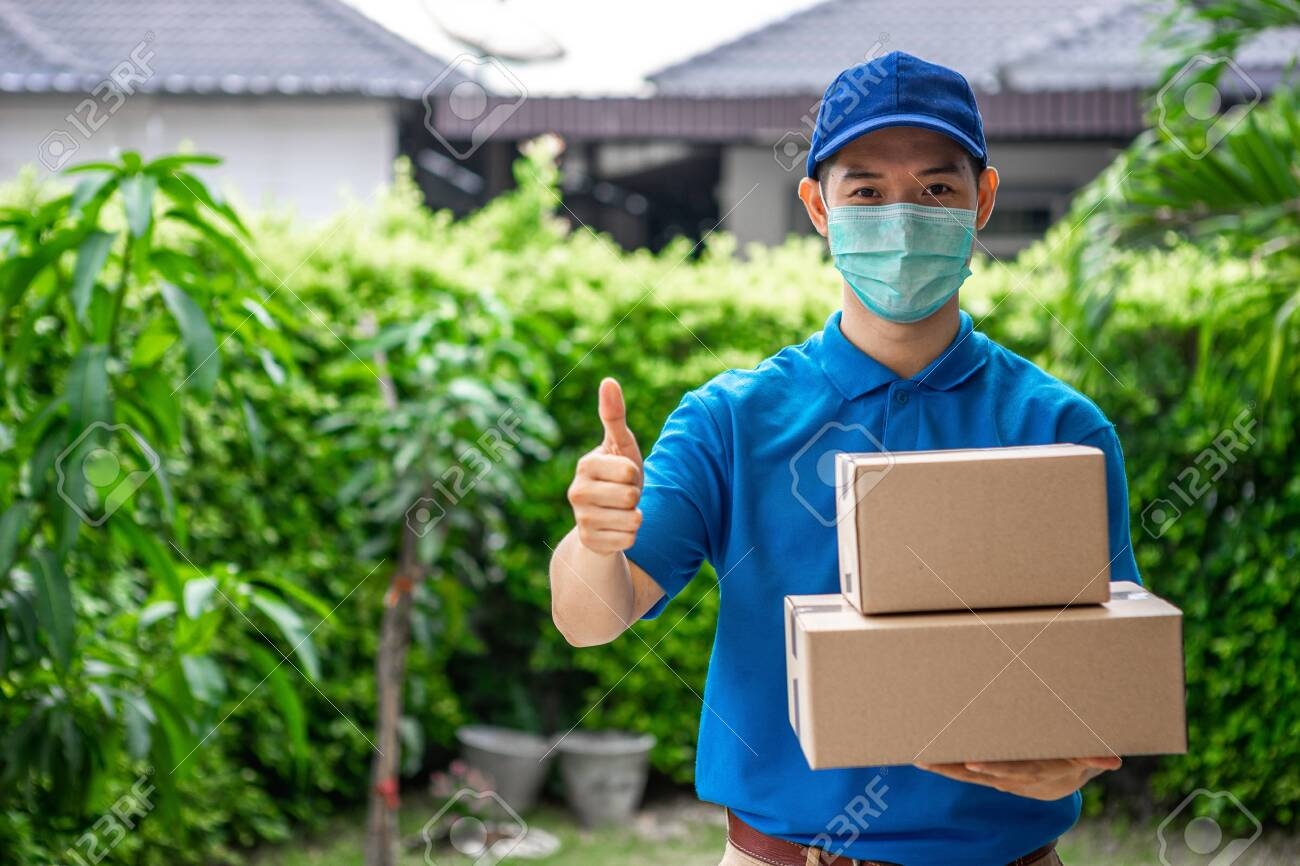 Asian deliveryman is delivering parcel to house her to sign to receive the product After she ordered online during the outbreak of the coronavirus or Covid-19 virus. - 148855852
