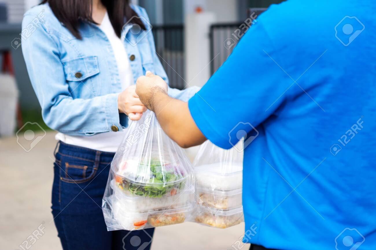 Asian delivery man delivering food, fruit, joice and vegetable to customer home - online grocery shopping service concept - 149473790
