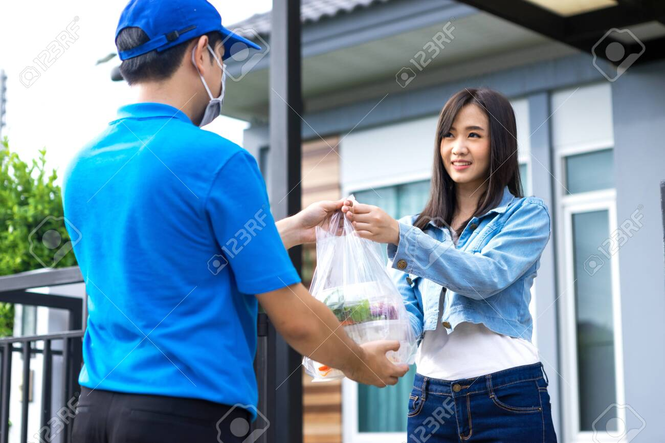 Asian delivery man delivering food, fruit, joice and vegetable to customer home - online grocery shopping service concept - 149473792