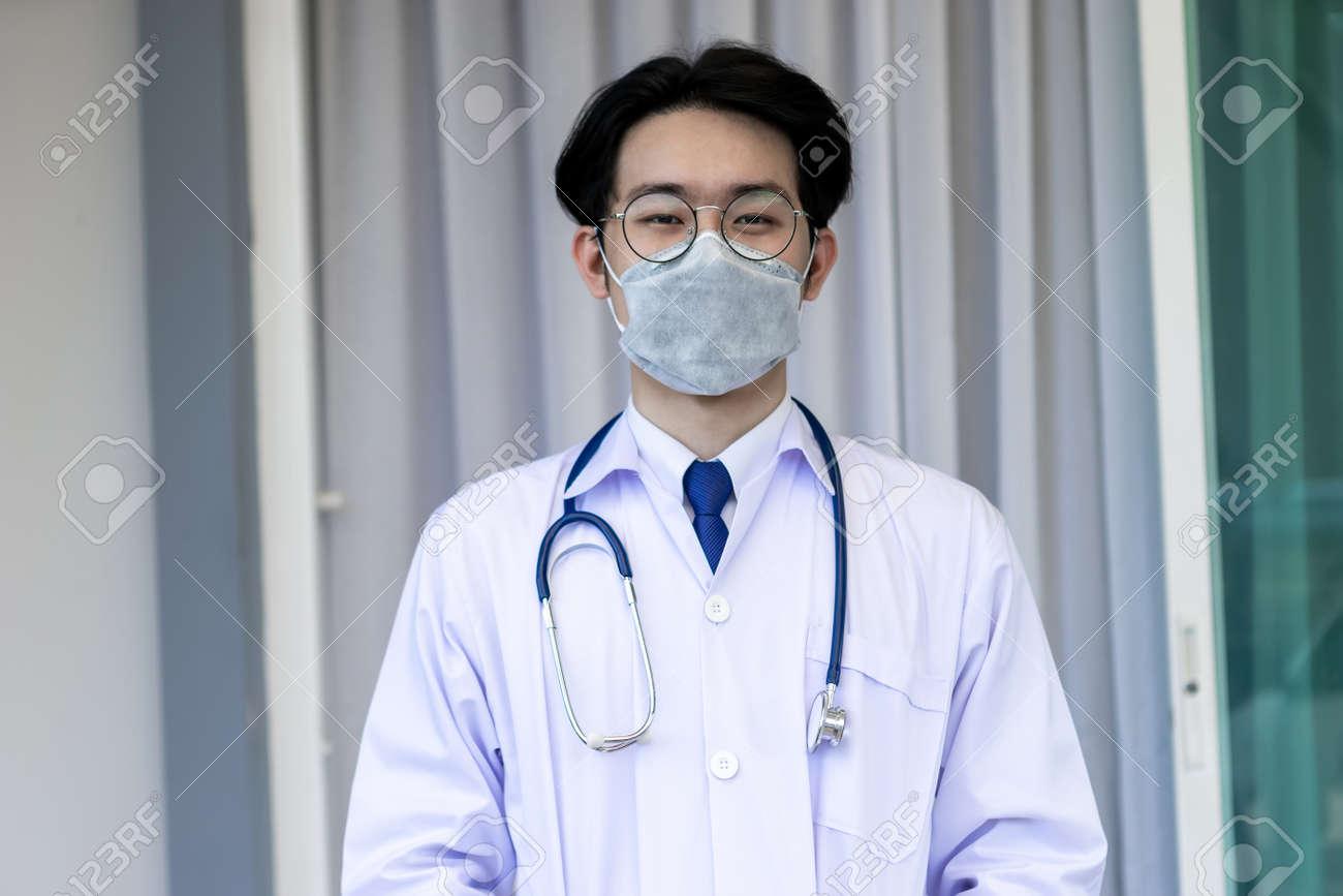 Portrait of Asian doctor man wearing stethoscope white coat standing in modern hospital. - 155233950