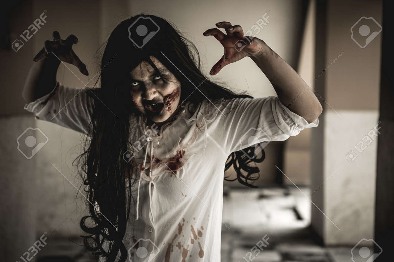 Woman in ghost or zombie on halloween festival at dark place, holding knife and wants to stab you. Horror or halloween festival concept. - 158692220