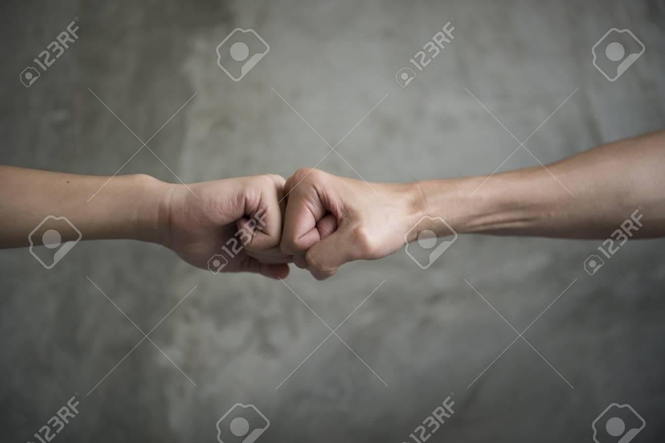 A close up image of a fist bump knuckle bump greeting and stock a close up image of a fist bump knuckle bump greeting and teamwork concept m4hsunfo