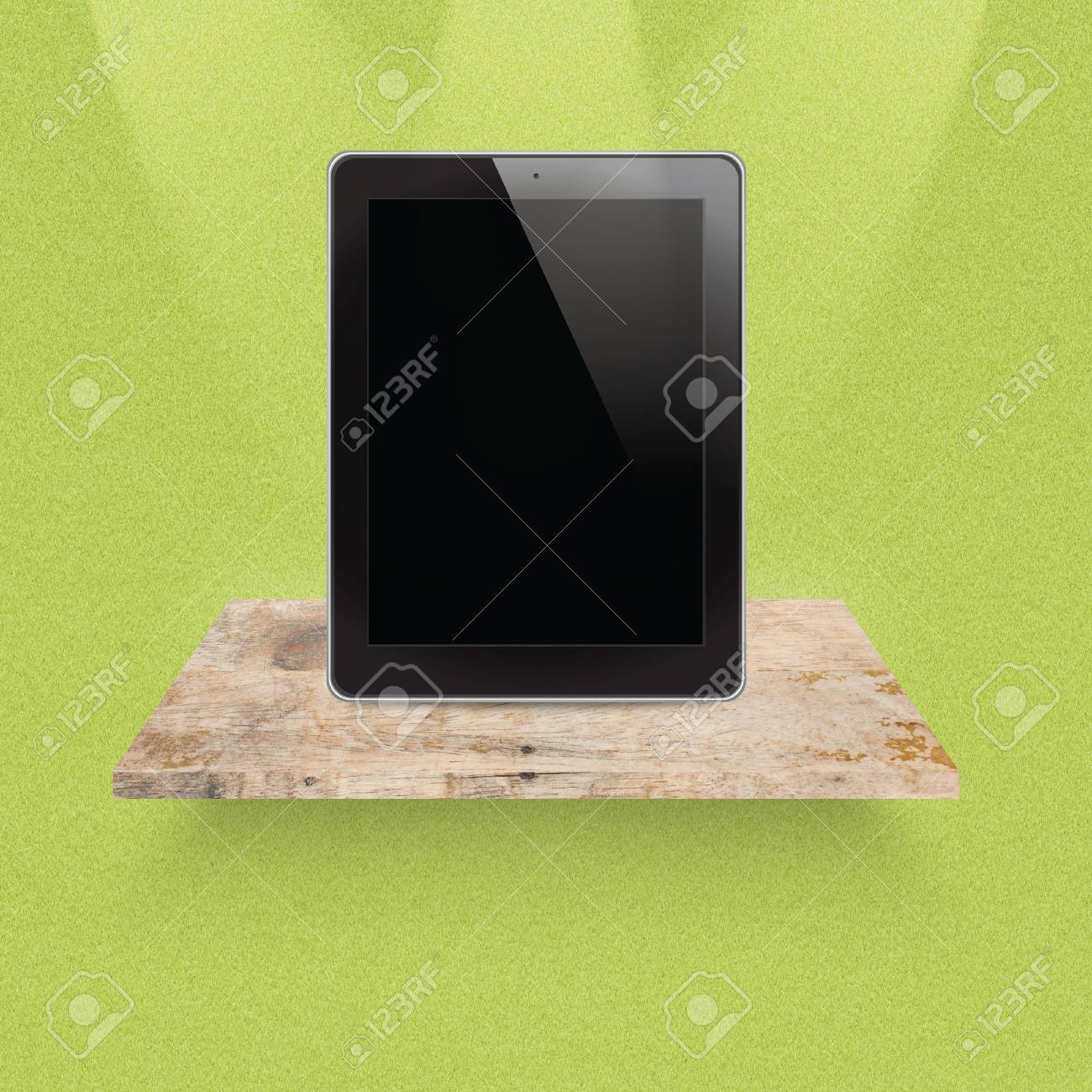 Tablet on empty shelf of wood for exhibition Stock Photo - 14890783