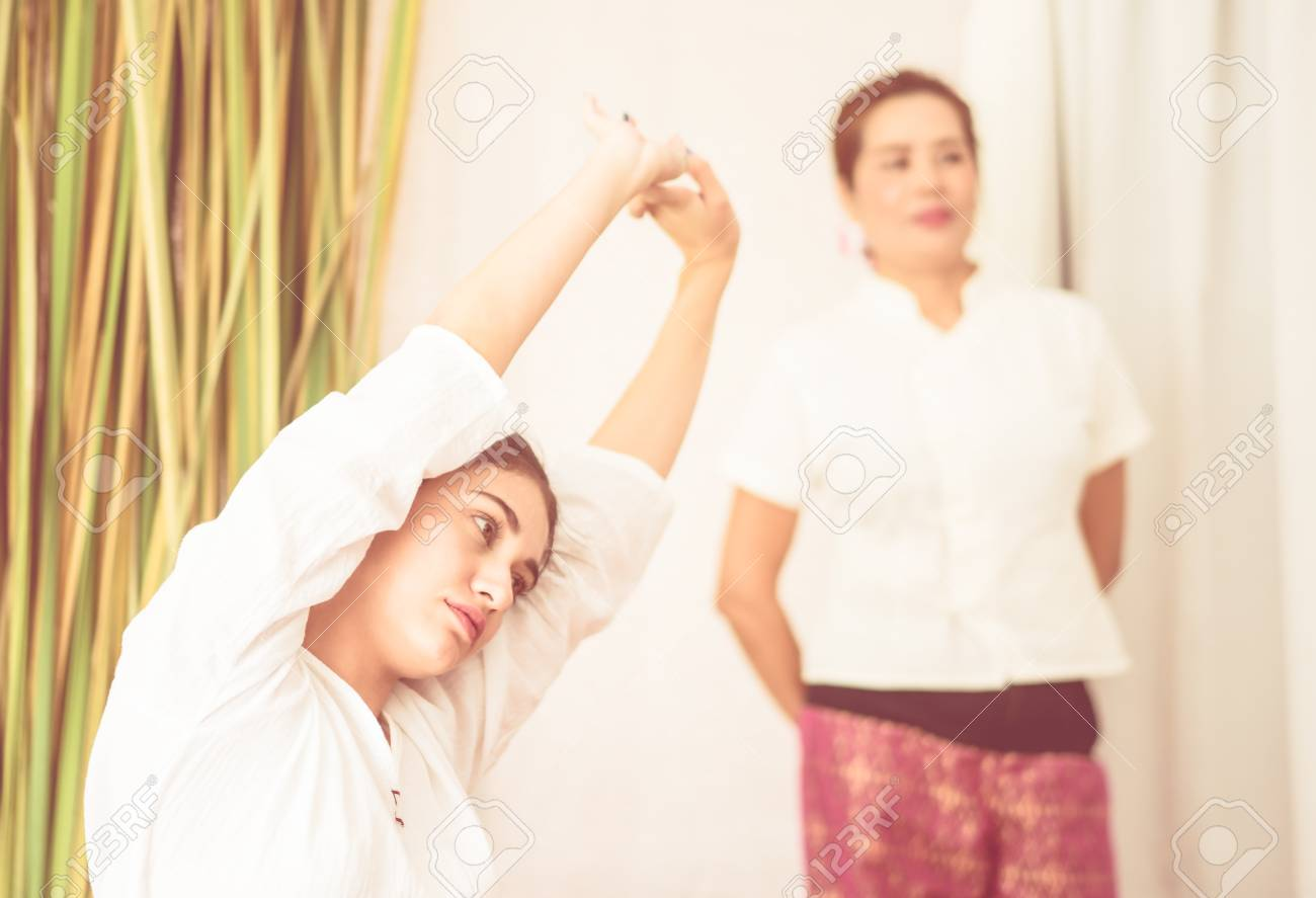 Women is stretching before Thai Massage course