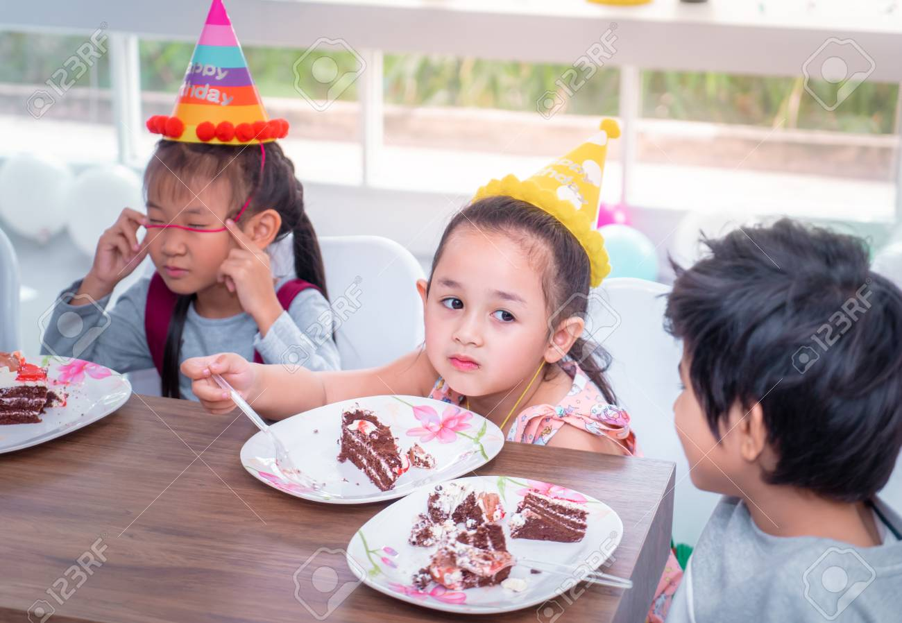 Superb Asian Children Is Happy Eating Her Birthday Cake In Party Stock Funny Birthday Cards Online Inifofree Goldxyz