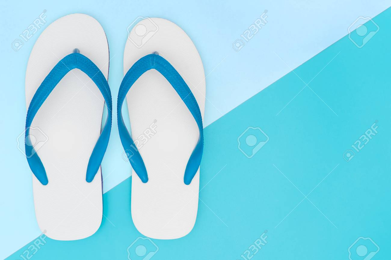 b64d3b17e Stock Photo - White Foam Beach Sandals on blue copy space
