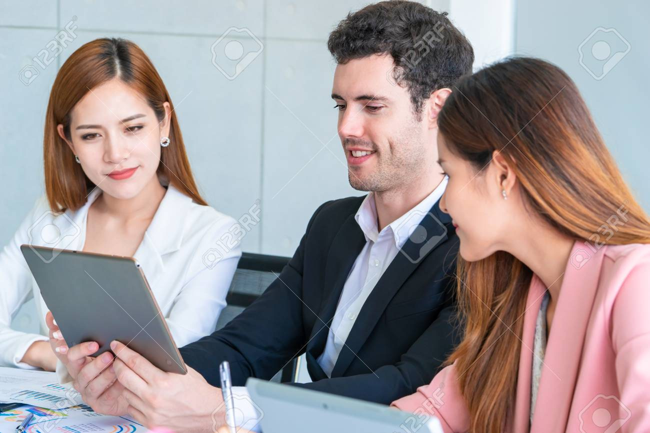 Three Business team is discussing on business in team meeting - 120286920
