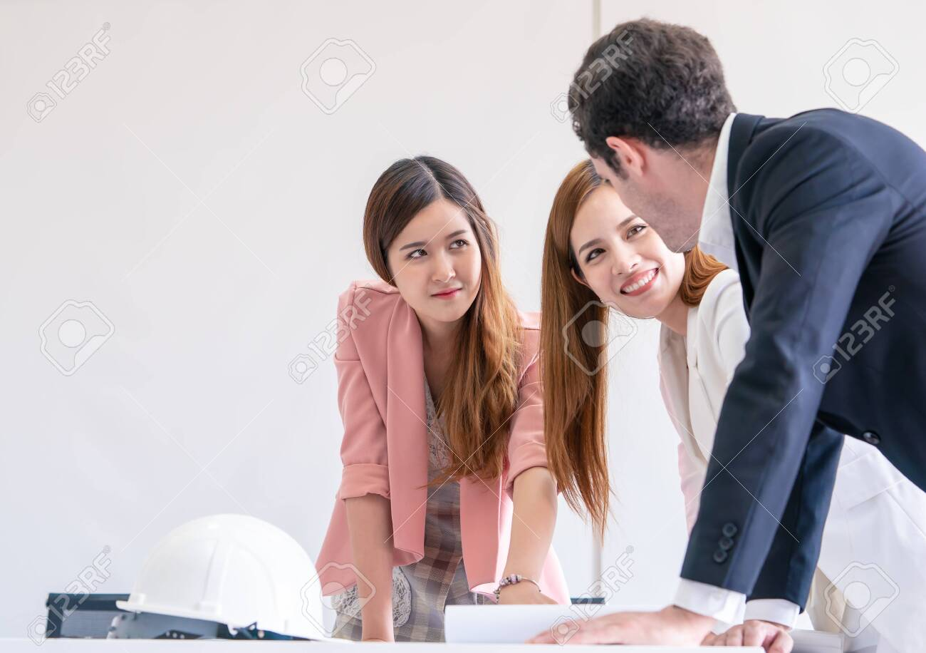 Construction Corporate is brainstorming in meeting with paper - 120287147