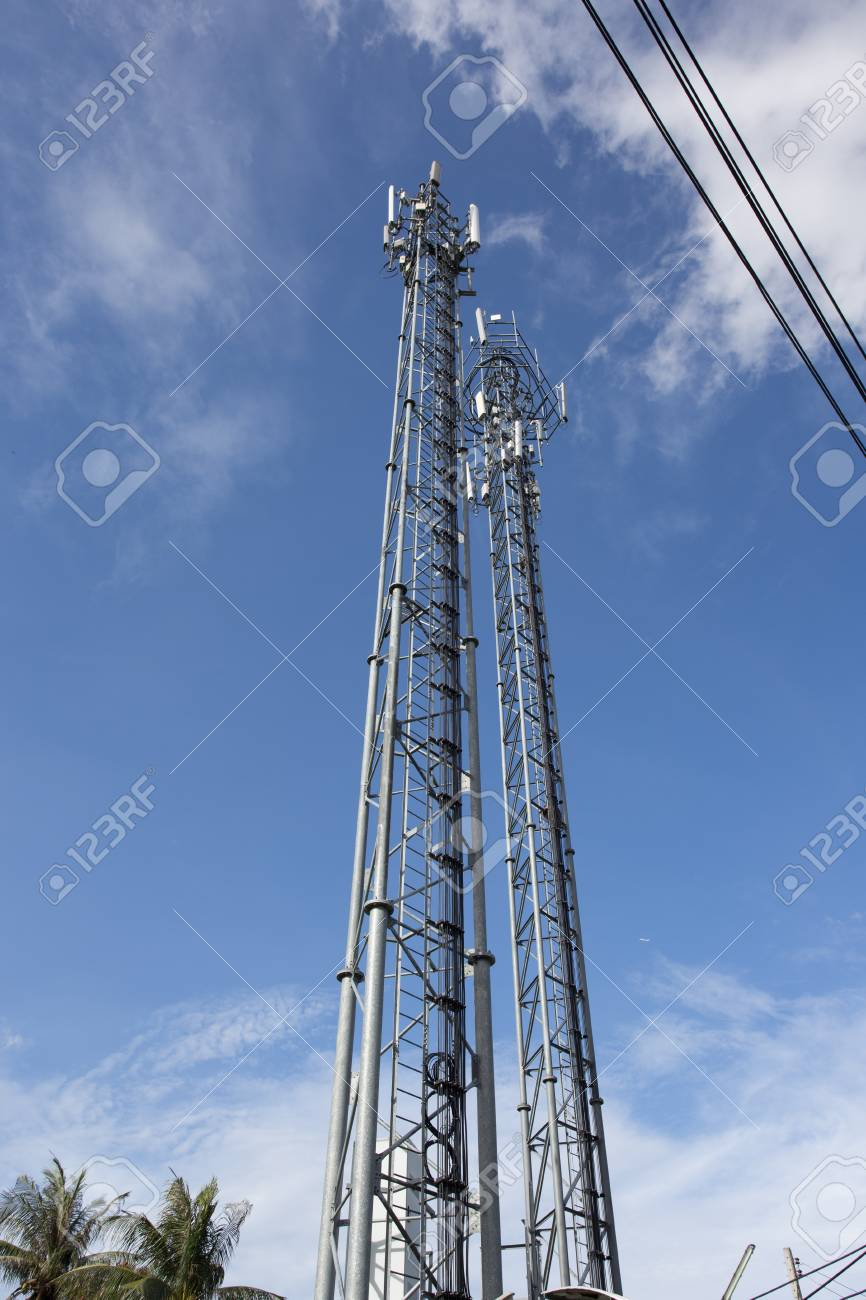 Telecommunication tower with antennas with blue sky repeater