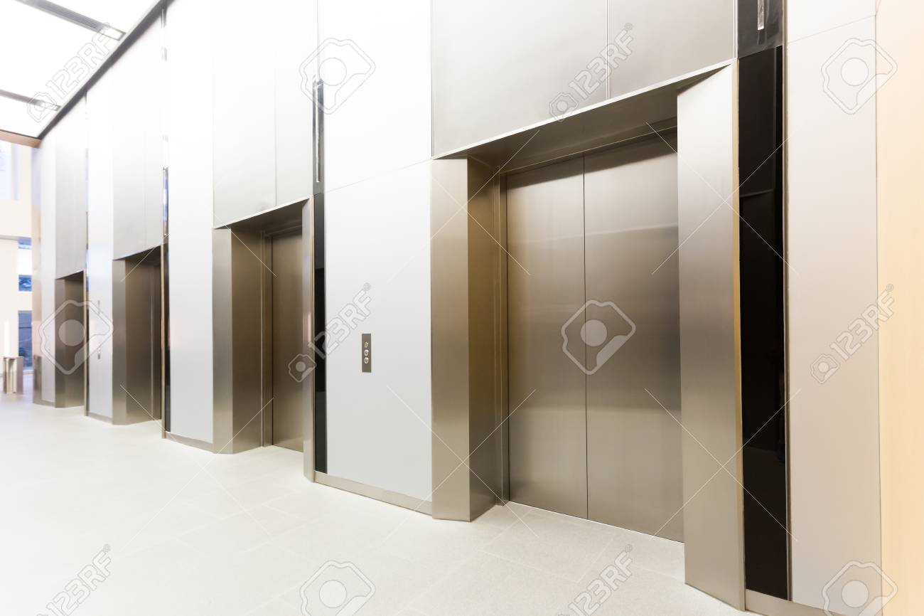 Modern Steel Elevator All Closed Cabins In A Business Lobby Or Hotel, Store,  Interior