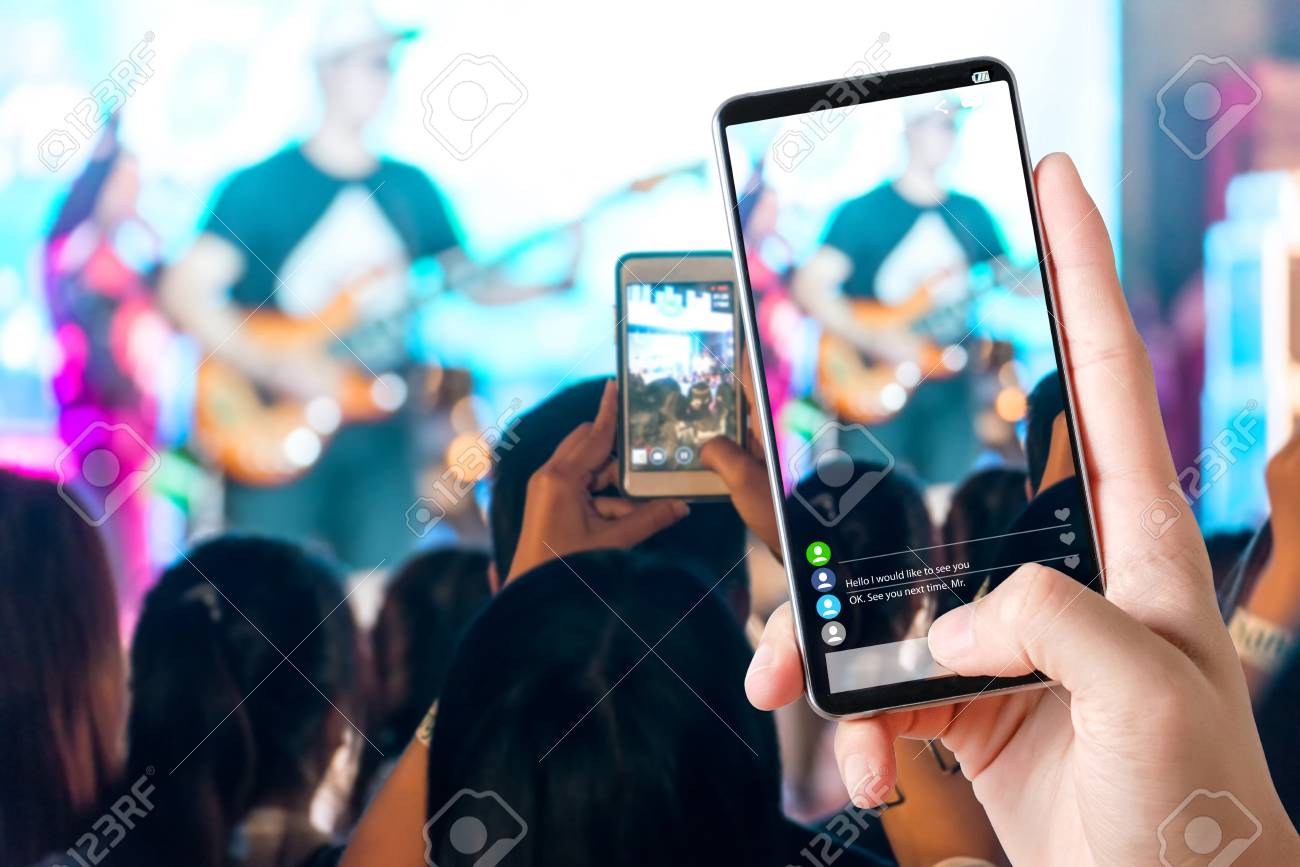People hands use smart phones record video concert music festival