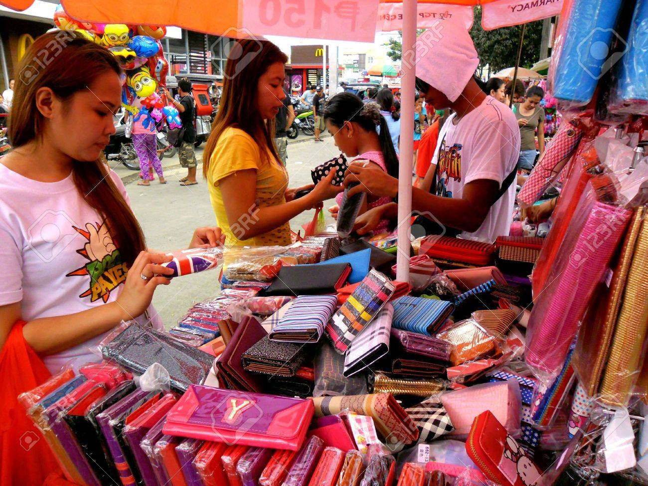 Vendor selling wallets in a market in taytay rizal philippines