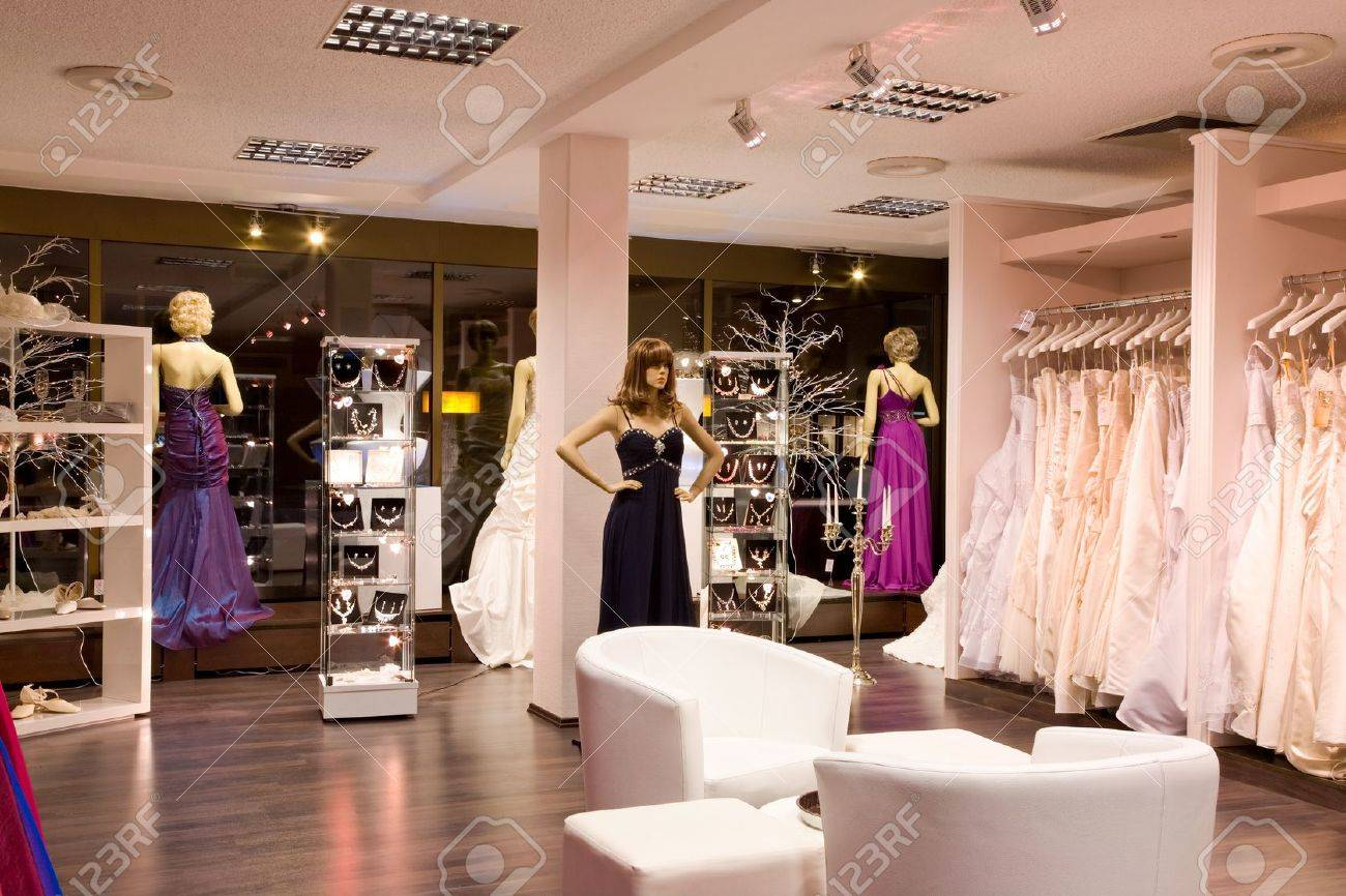 Mannequins In Wedding And Evening Gowns In The Bridal Shop. Stock ...