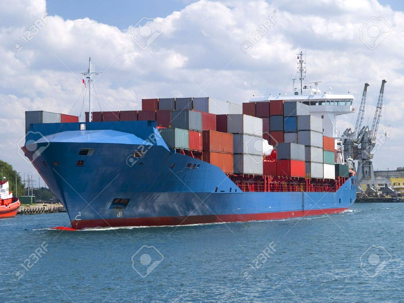 Huge container cargo ship heading for port Stock Photo - 7836883