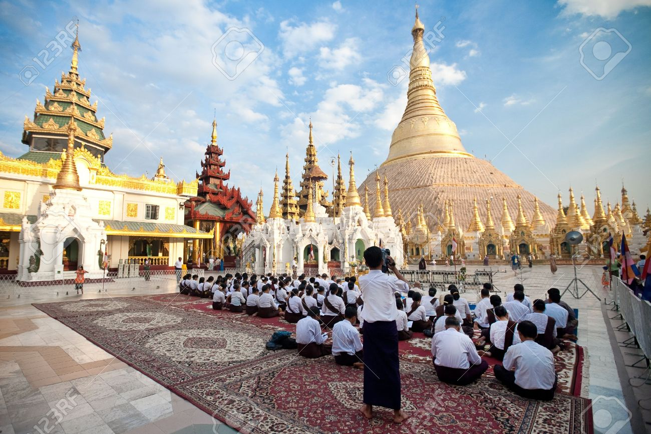 14685715-YANGON-MYANMAR-JAN-28-Buddhist-devotee-praying-at-the-full-moon-festival-Shwedagon-Pagoda-January-28-Stock-Photo.jpg
