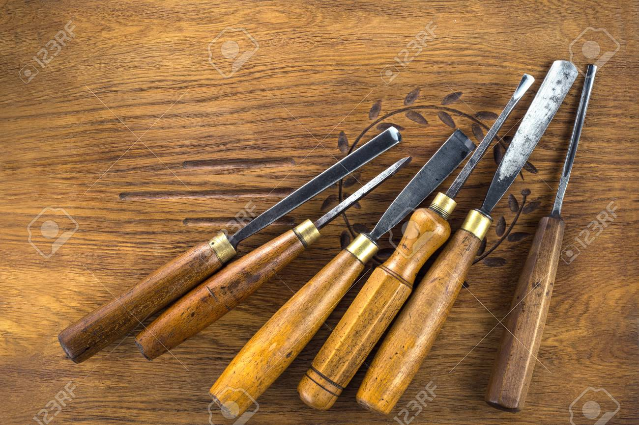 photo set of wood chisel for carving wood sculpture tools on wooden background