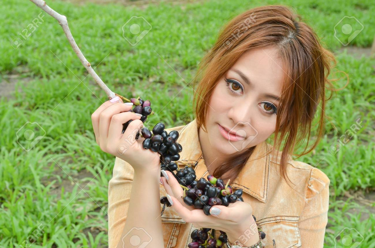 Beautiful woman eat fruit in the park Stock Photo - 13235063
