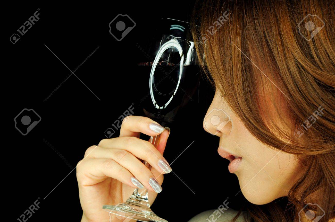 Beautiful woman with wine glass in hand Stock Photo - 13421380