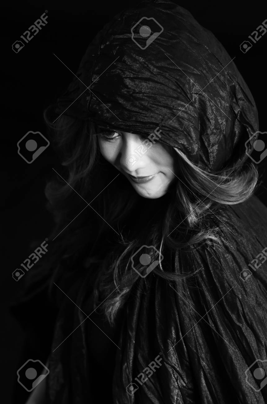 Mysterious portrait of young beautiful woman in the black dress Stock Photo - 14158495