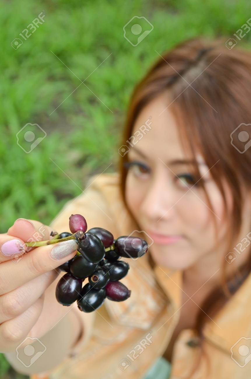Beautiful woman eat fruit in the park Stock Photo - 14158523