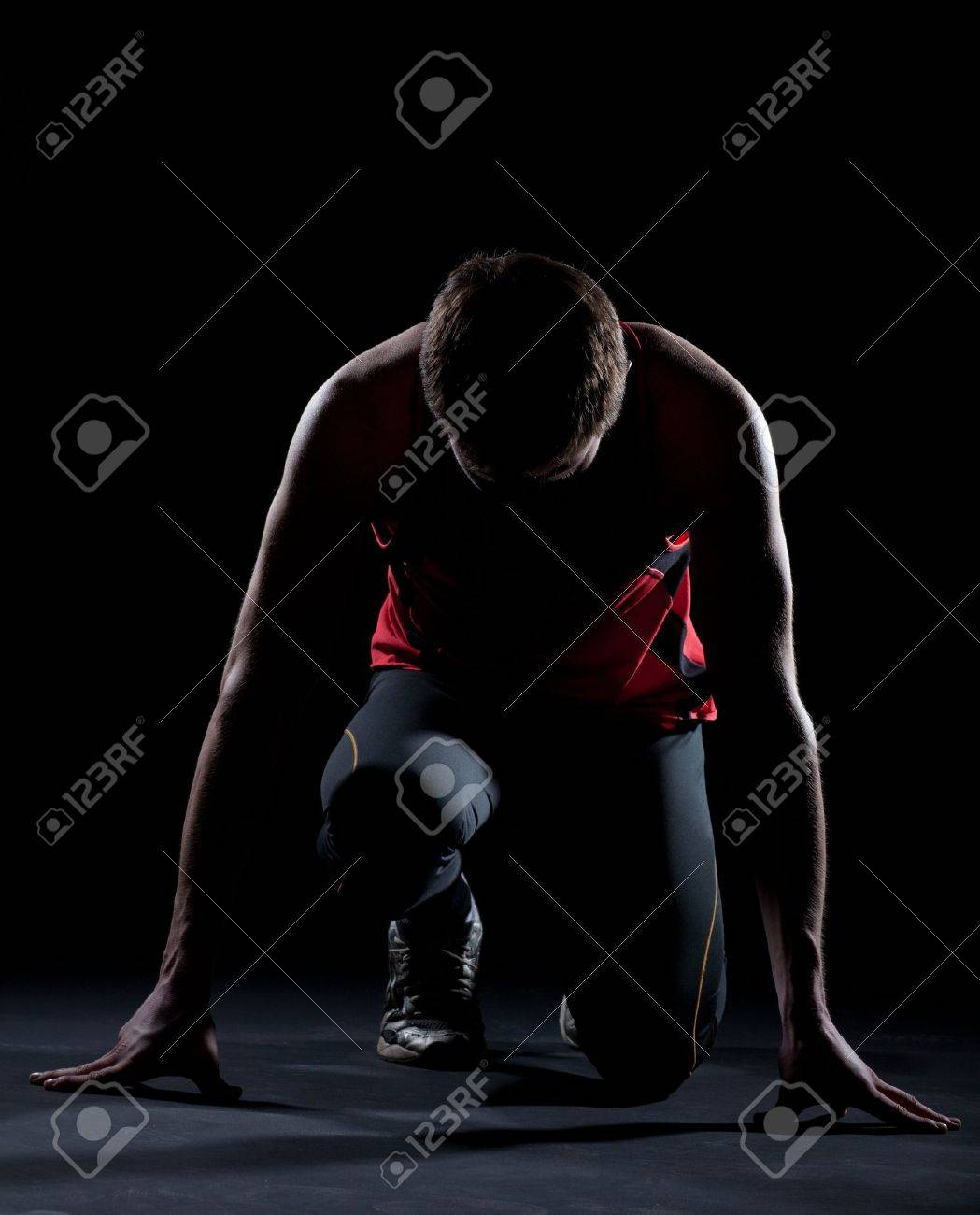 Athlete ready to start on black background Stock Photo - 9028611