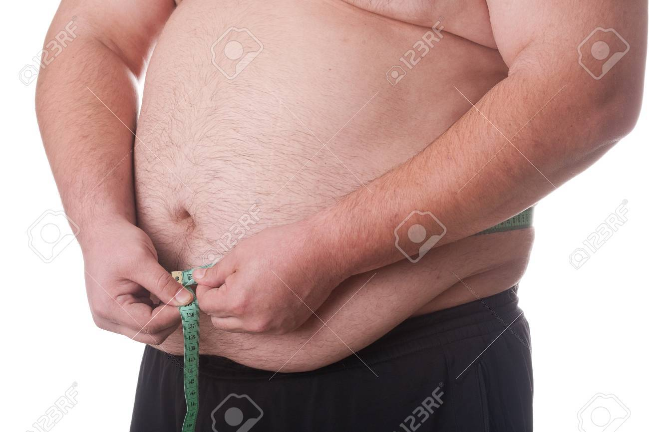 Fatman with measurement tape on white Stock Photo - 13561334