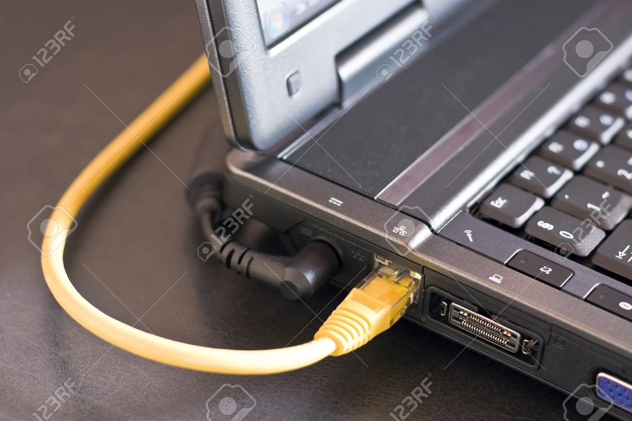 laptop cables are connected to the Internet. Stock Photo - 5264569