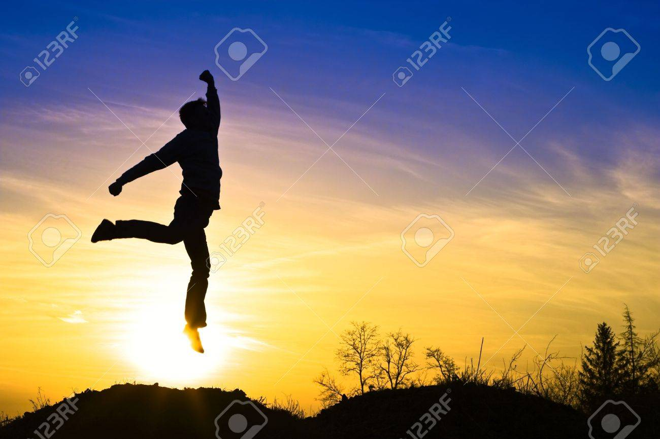 Man in the sunset, happy and jumps. Stock Photo - 6876215