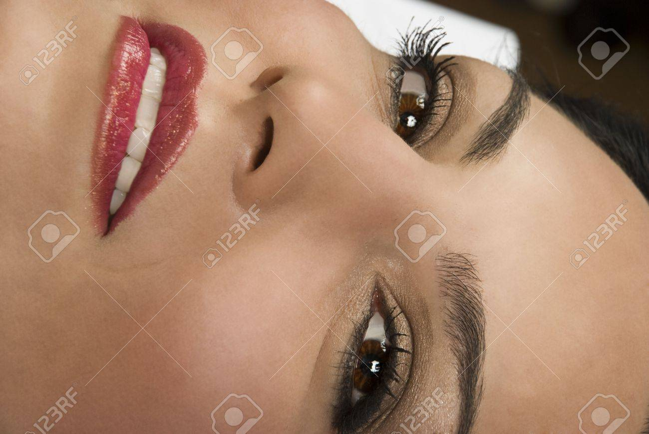 Close up of smiling beautiful woman face looking at you Stock Photo - 4415966
