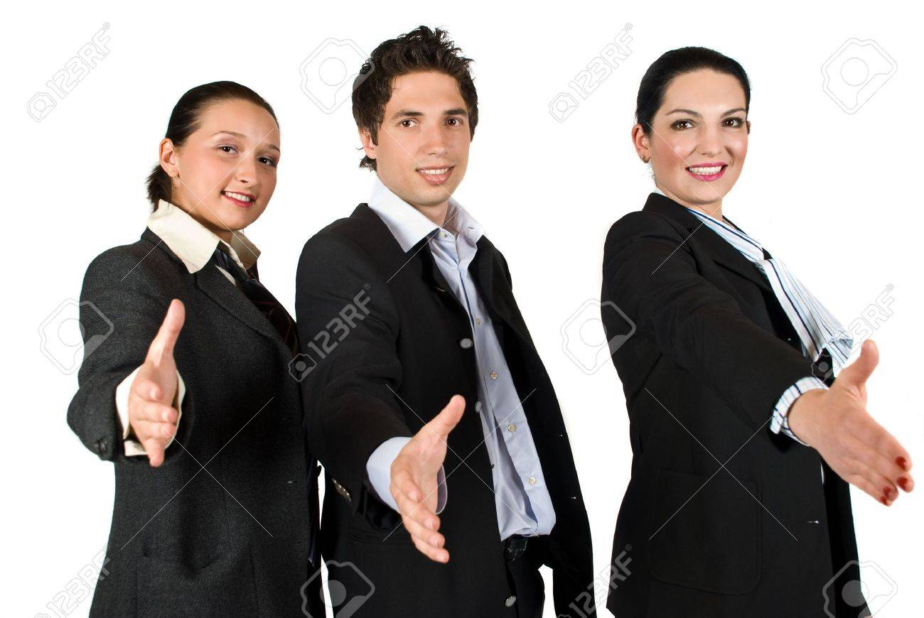 Staff of three business people teamwork standing with hands stretched offering  handshake Stock Photo - 4781170