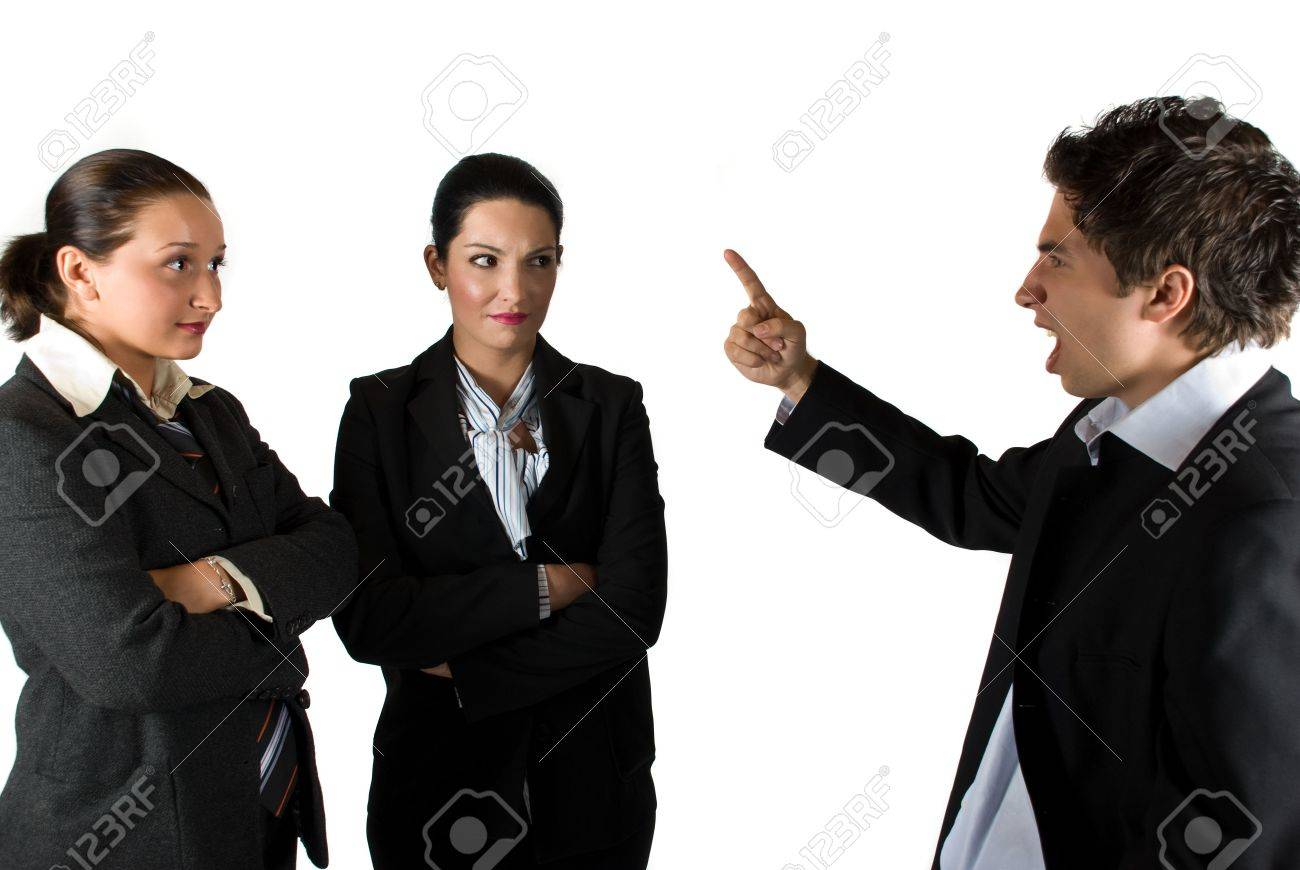 Angry boss businessman screaming and pointing to his colleagues businesswoman who listen him shocked - 4837513