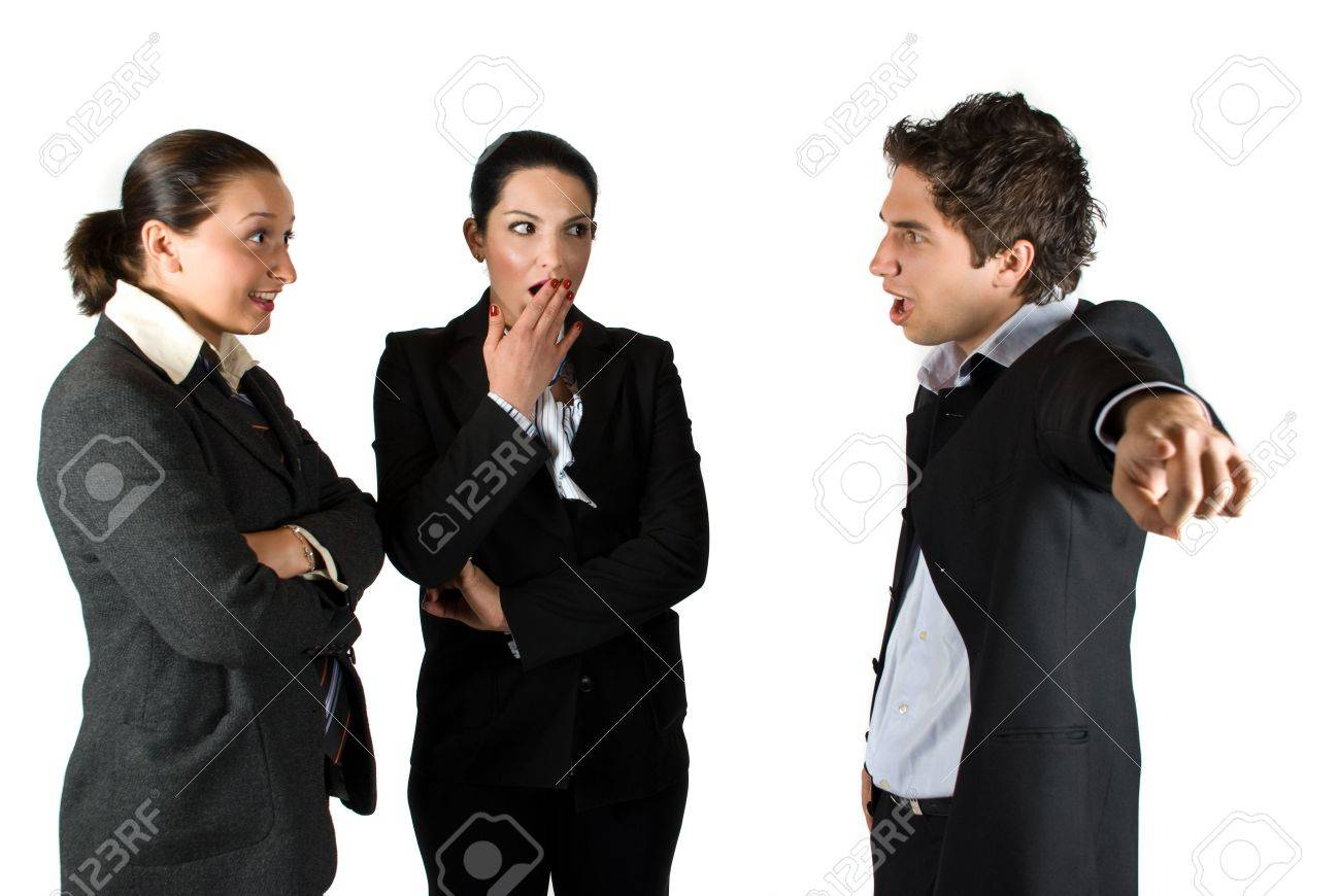 Mad businessman boss screaming :You are fired! and pointing out at two employees woman,the brunette businesswoman it is shocked and surprised and put her hand at mouth and the other making a smiley face like she say:What? Stock Photo - 4850857