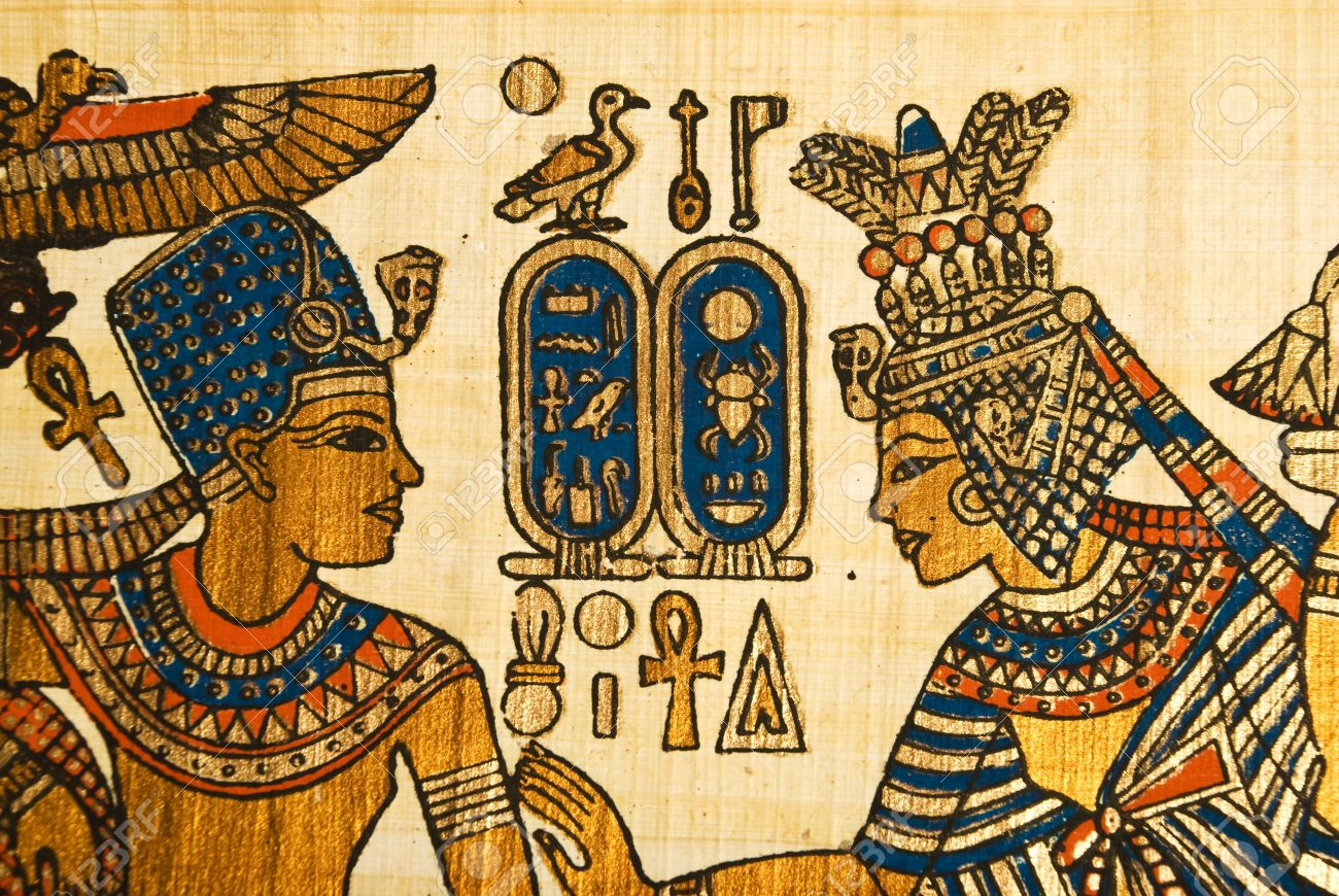 Papyrus Showing King And Queen In Profile With Egyptian Hieroglyphics Symbols Stock Photo
