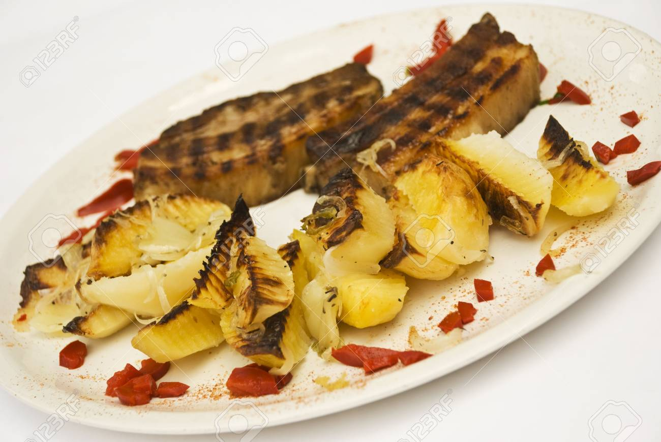 Roasted pork with rustic potato on a white plate decorated with bell pepper Stock Photo - 5228060