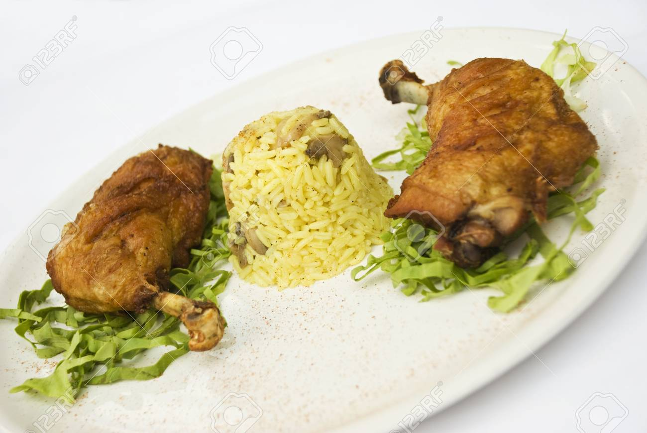 Roasted chicken legs with  rice garnish and green salad on a white plate Stock Photo - 5228057
