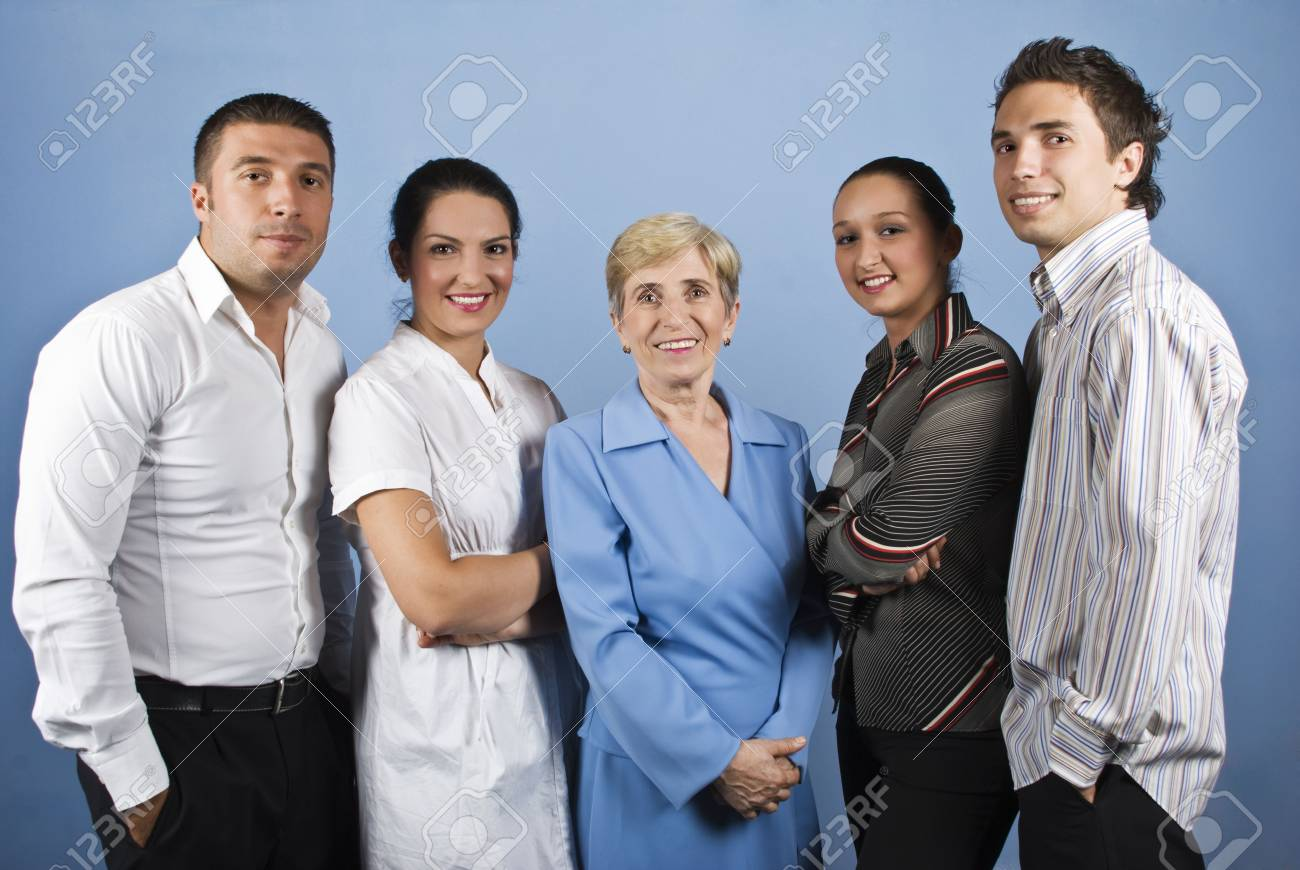 Portrait of happy smiling business people group standing in front of image on blue background Stock Photo - 5381554