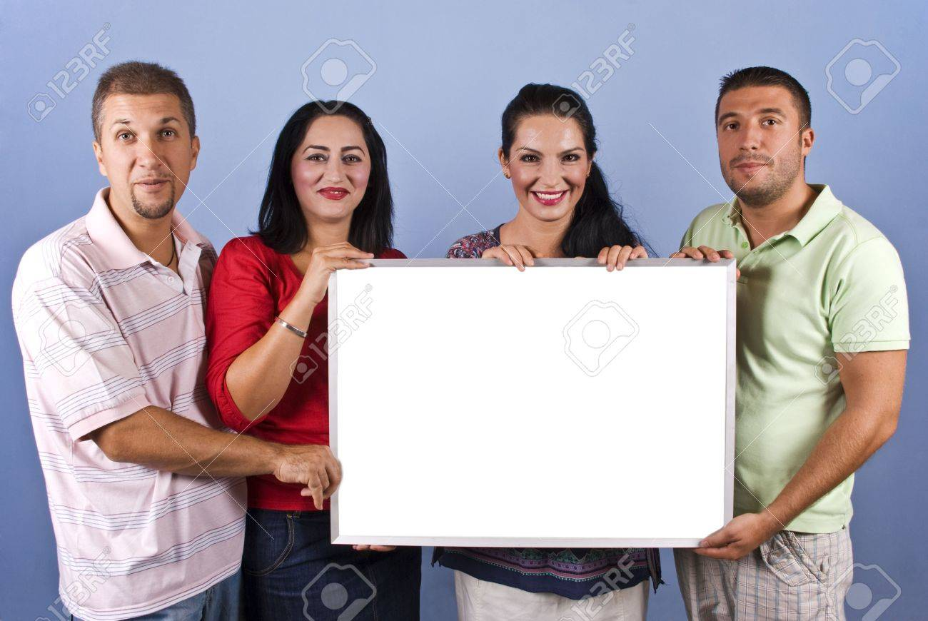 Four mid adults friends 30-34 years age holding a white blank banner and smiling together on blue background,copy space for text message on card Stock Photo - 5464702