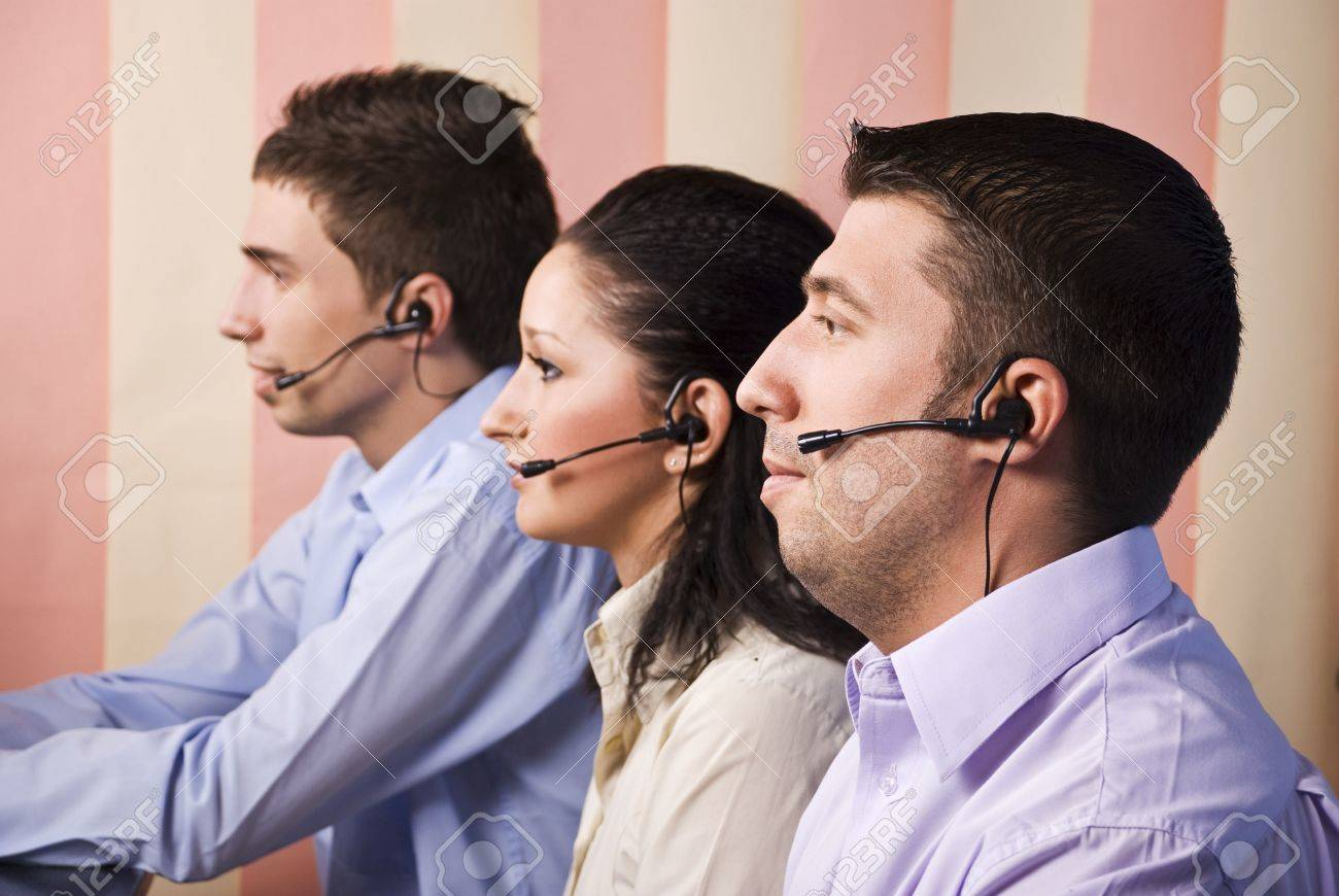 three people customer service representative working in office stock photo three people customer service representative working in office looking screen and standing in profile vertical blinds background