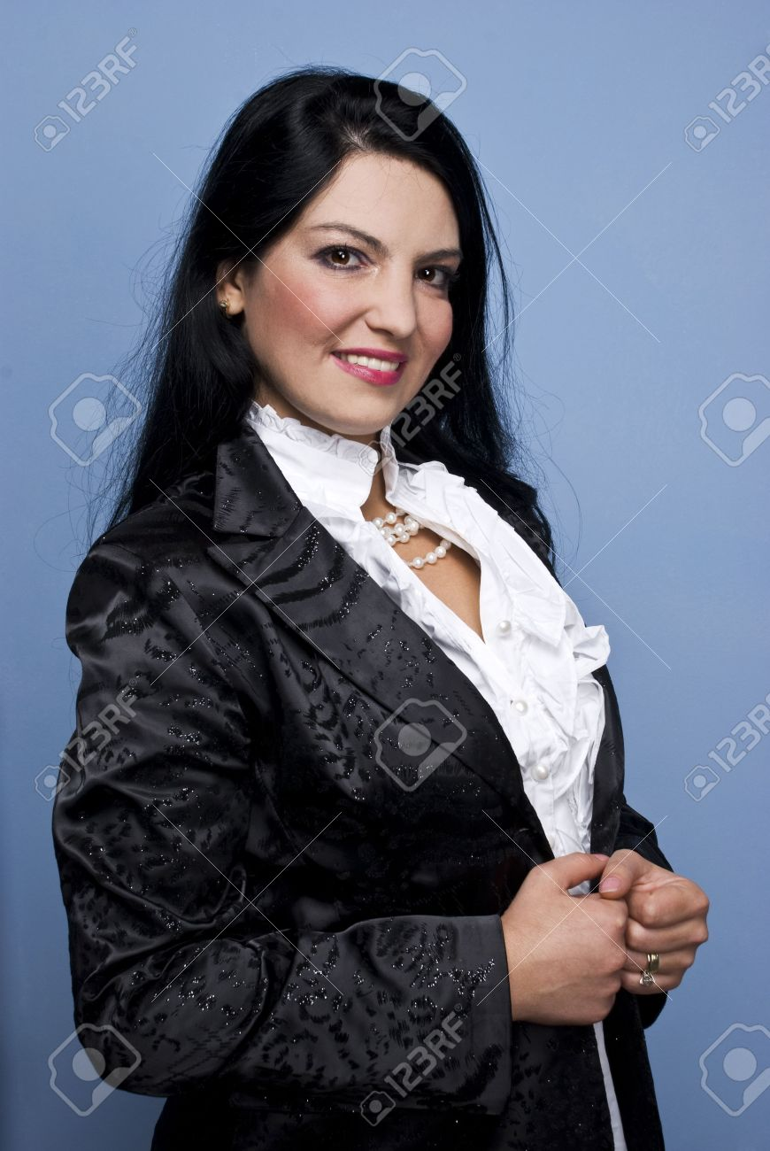 Beautiful smiling elegant woman standing in profile and looking at you,she  wearing a shinny