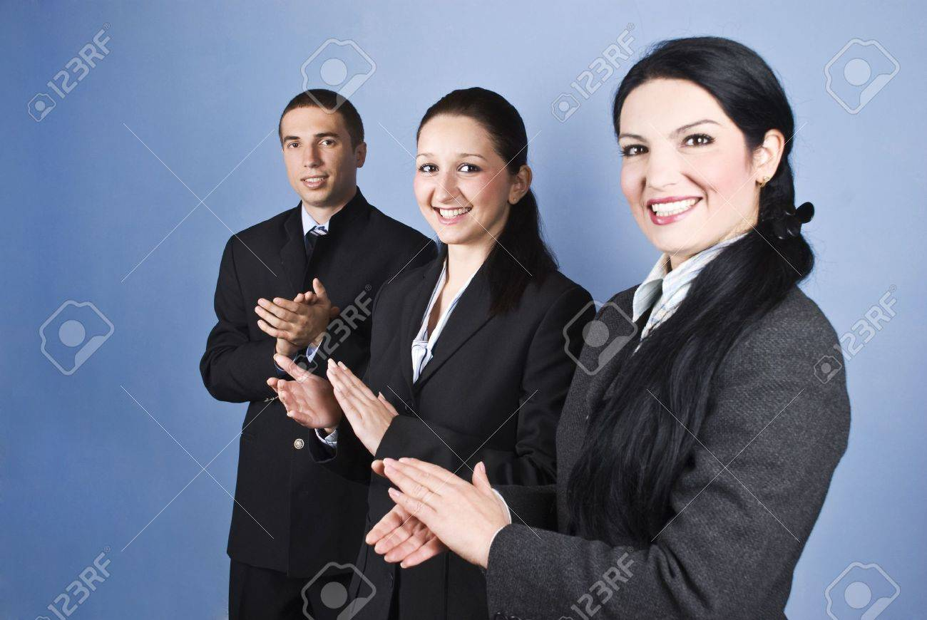 Congratulations!Successful business team people clapping and smiling over blue background Stock Photo - 5878568