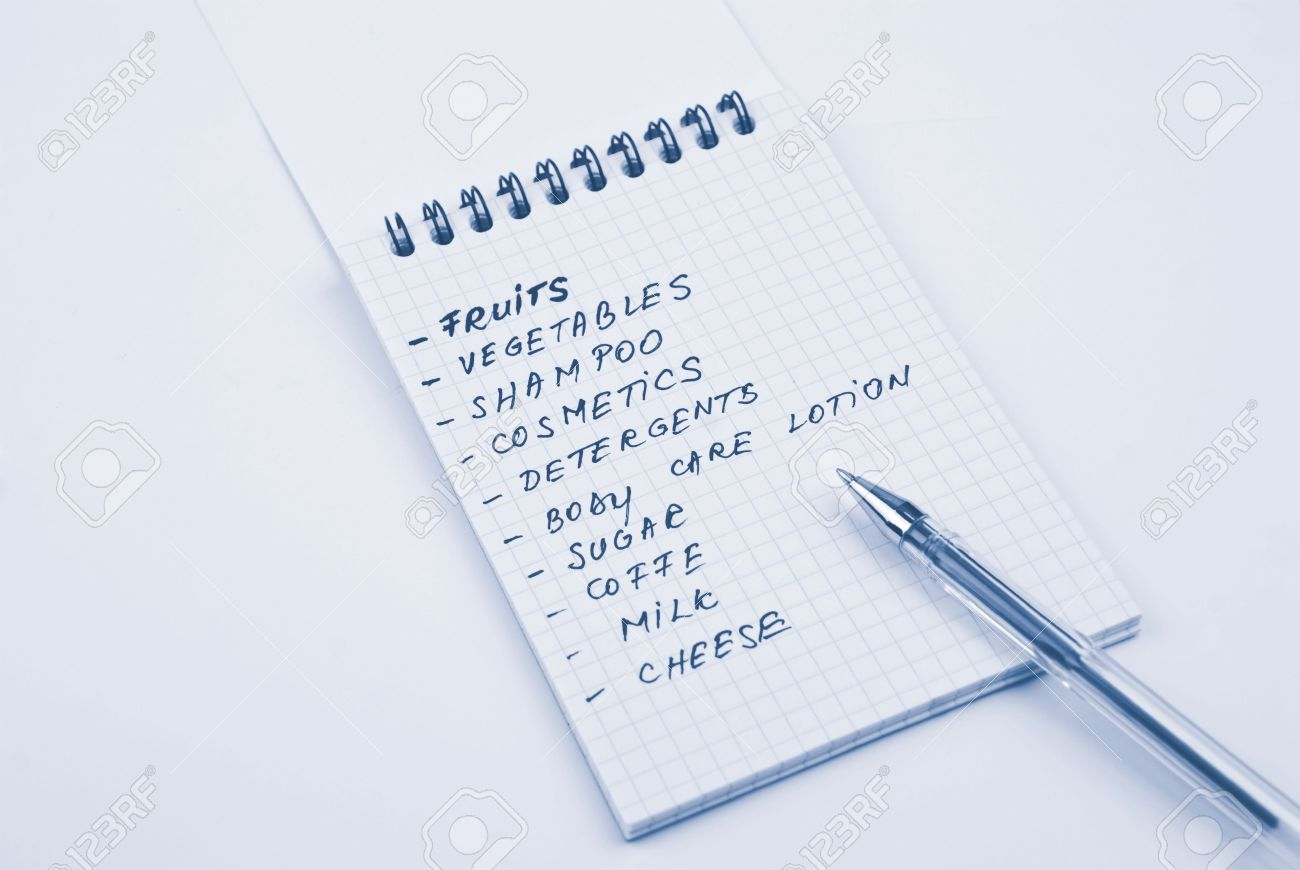 shopping list handwritten with blue pen in a notebook stock photo