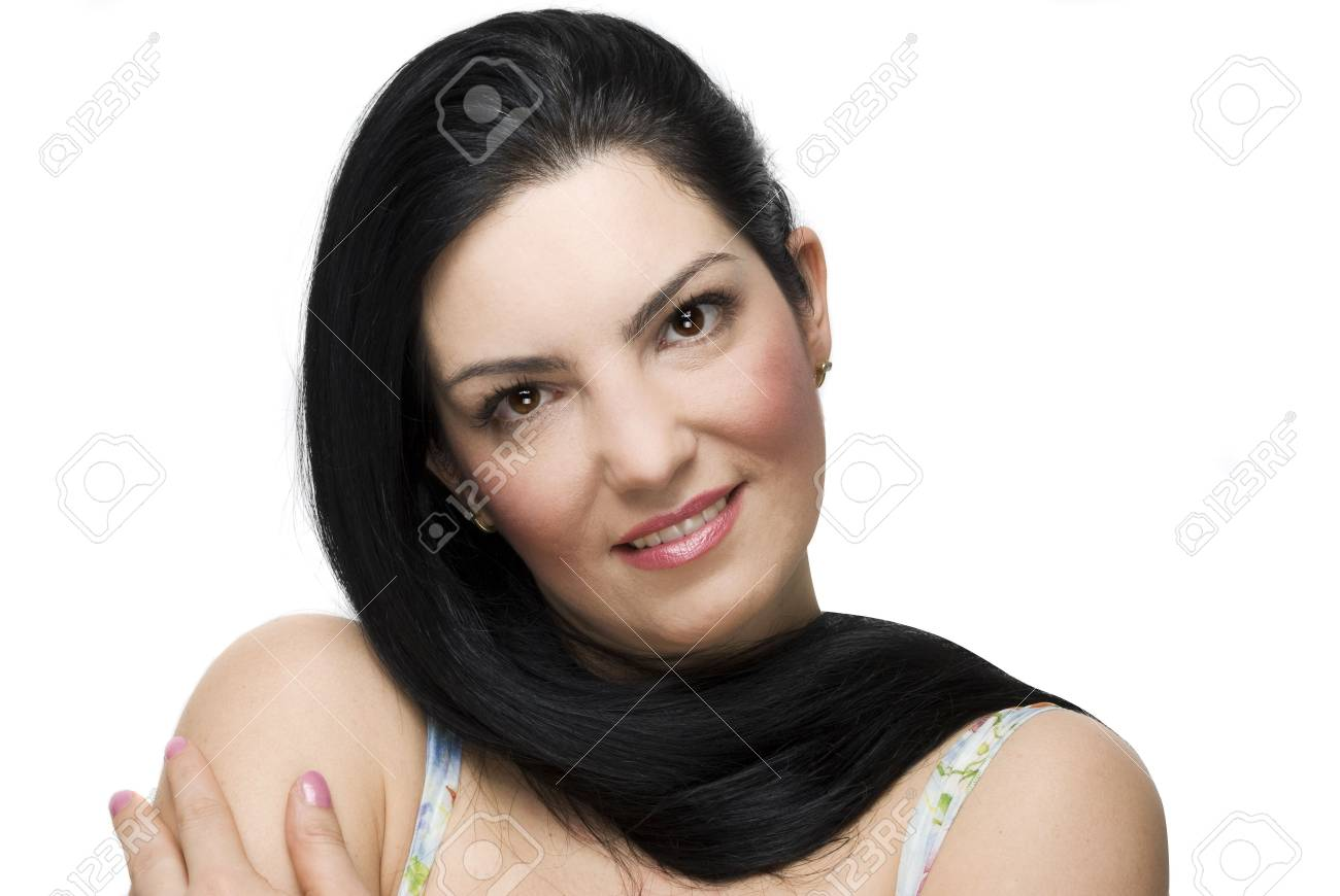 Beautiful young brunette woman posing with her  long hair around neck and holding hand on shoulder isolated on white background Stock Photo - 6304758