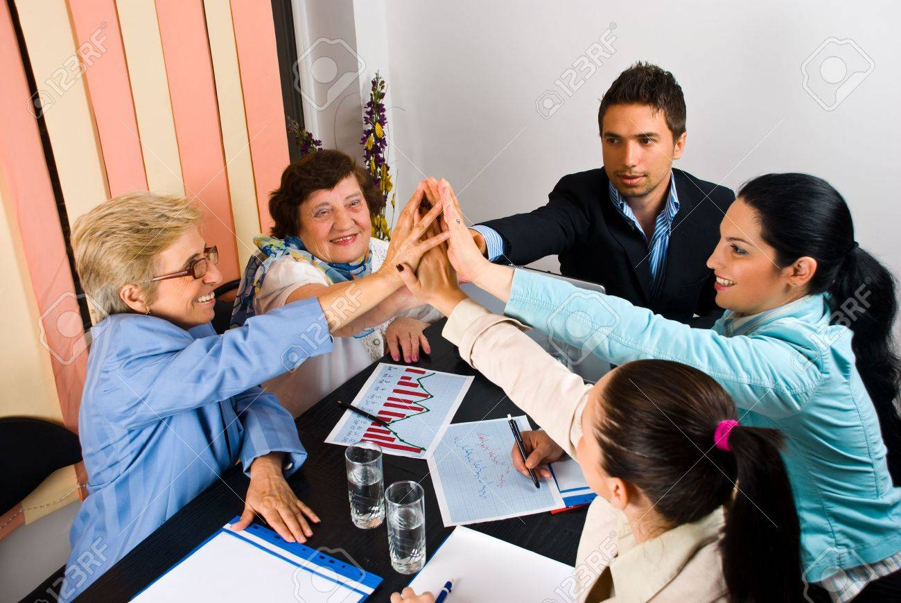 High five of businesspeople with success in business or team spirit Stock Photo - 7168932