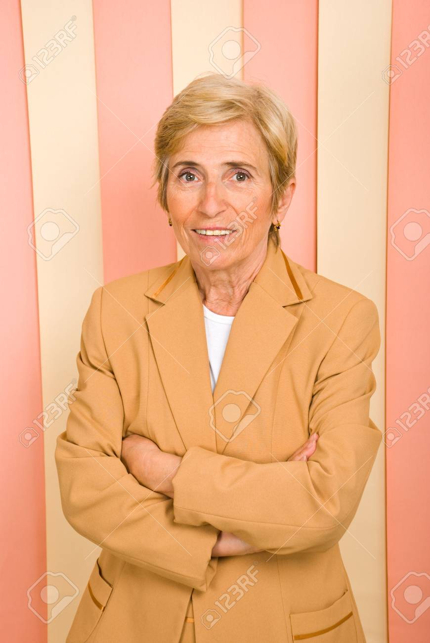 Blond senior business woman standing with hands crossed and smiling Stock Photo - 7209430